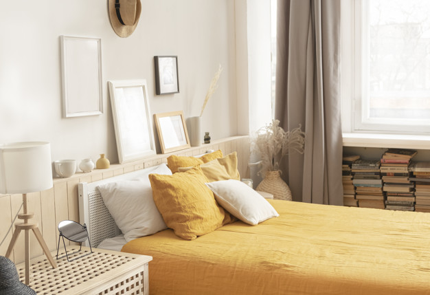 cozy-bright-bedroom-rustic-style-bed-with-bright-yellow-linens_129447-137