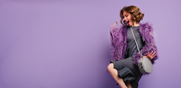 stunning-barefooted-woman-trendy-fur-coat-dancing-laughing-photoshoot_197531-7073